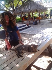 Ary the dive instructor is teaching the cat , Lazy, how to dive